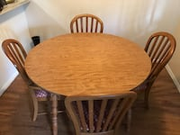 round brown wooden table with four chairs dining set San Antonio, 78218
