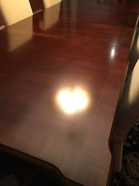 "Table with two matching arm chairs. Extends to 110"" with two leafs Caledon, L7E 4H7"