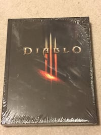 Brand new sealed. diablo iii the official limited edition strategy (hardcover) guide with sculptured metal bookmark (see photo).   a must have for diablo fans. awesome gift.    $35 *sale* Calgary, T2E