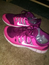 Pink and white womens Nikes