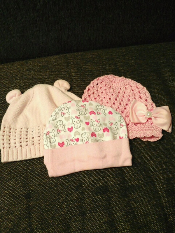 baby's white and pink knit caps