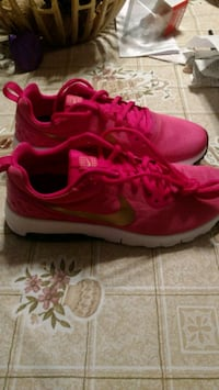 Girls Pink and Gold Nike