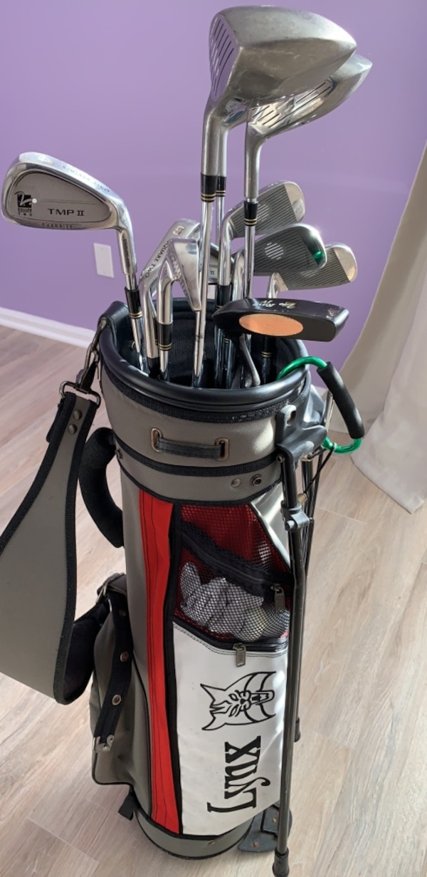 Black and red golf bag with golf clubs