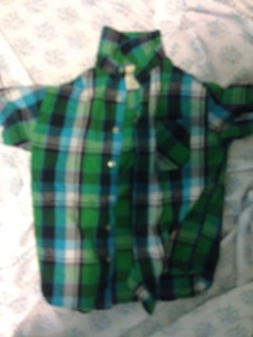green and black plaid polo