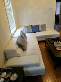 White leather sectional sofa. Almost new