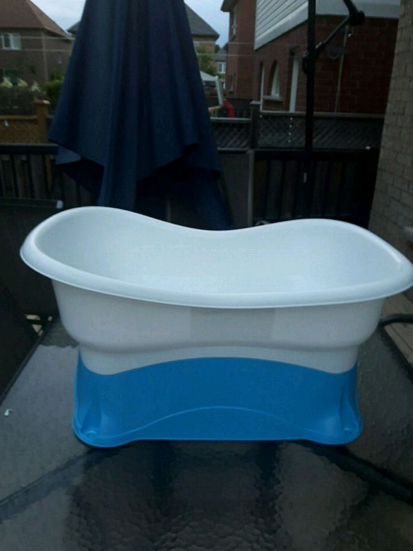 baby's blue and white plastic bather