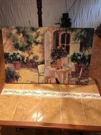 table and chain set near white painted house painting