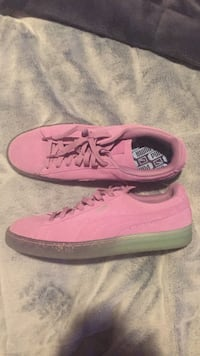 Pair of pink puma low-top sneakers