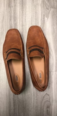 Pair of brown leather loafers Vancouver, V5X 3T6