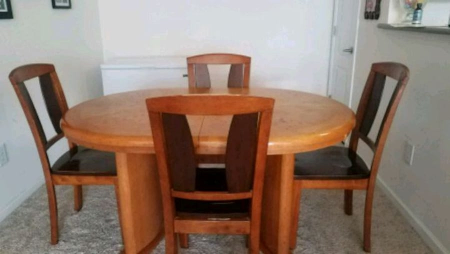 Solid wood Dining table . If you see the ad it's still available  e081f424-601a-43ee-a306-ce275d71aa78
