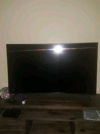 black flat screen TV with remote control Charlotte, 28262