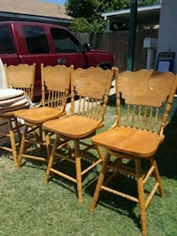 two brown wooden windsor chairs Manteca, 95337