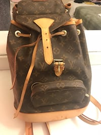 LV authentic backpack! Taking offers because it's stained but no low balls