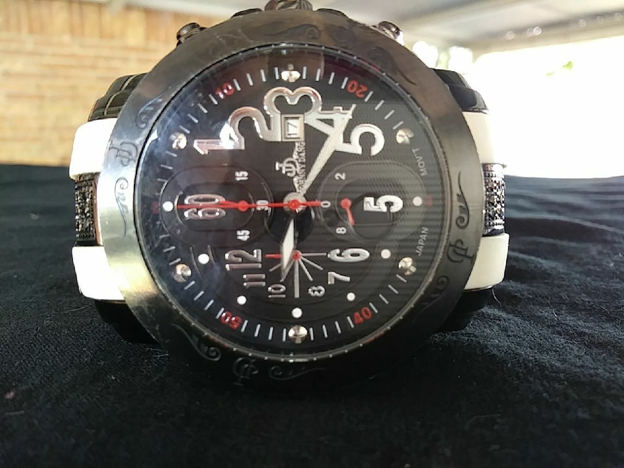 round black chronograph watch with leather strap