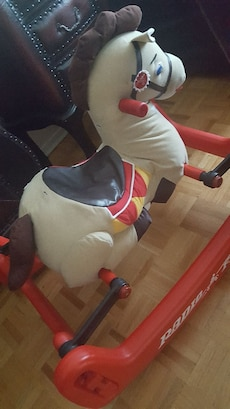 white and orange rocking horse
