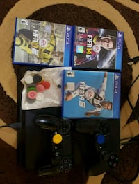 black Sony PS4 with controllers and game cases Pembroke Pines, 33025