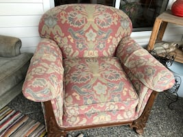 Brown and beige floral padded armchair