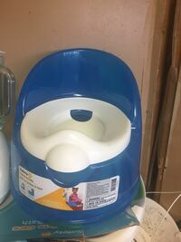 Blue and white plastic potty