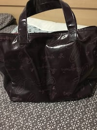 Black leather tote bag with wallet