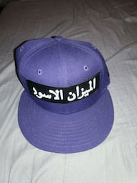 Black scale Arabic logo fitted