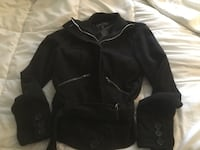 Women's wool coat size medium. has zipper buttons and a belt.. Reminderville, 44202