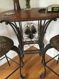 brown wooden table with black metal base 406 mi