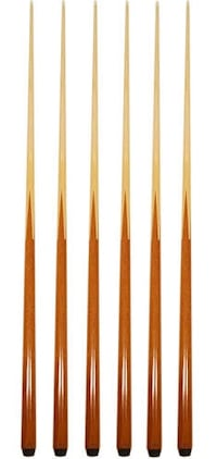Assorted used pool cues in various weights