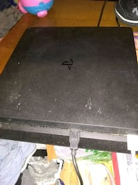black Sony PS4 game console Jamestown, 14701