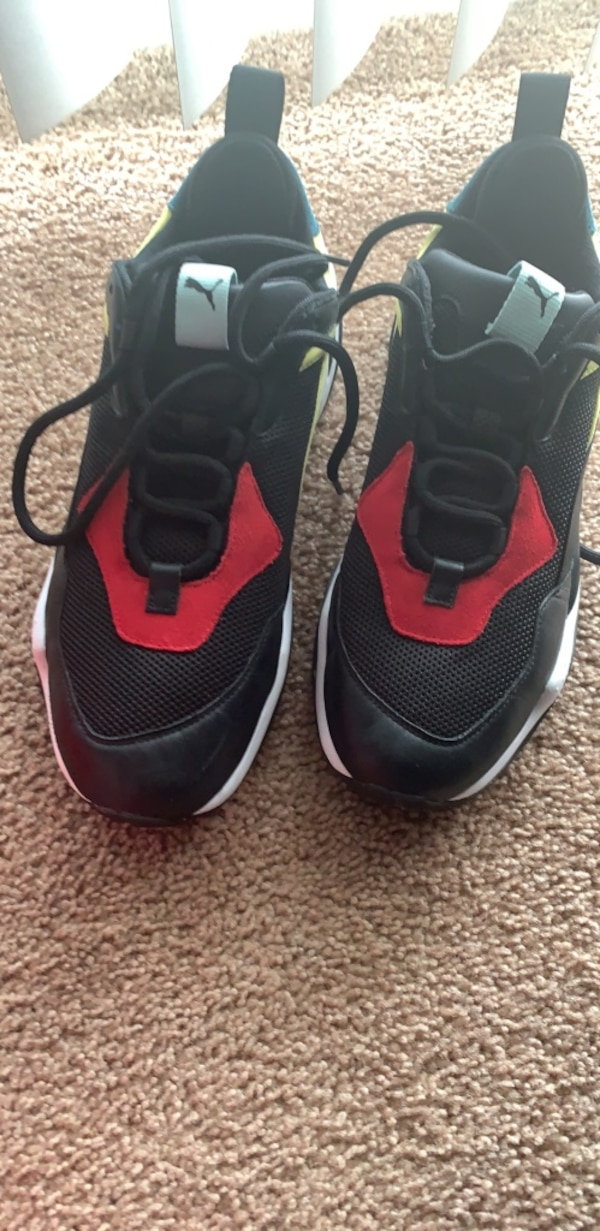pair of black-and-red basketball shoes