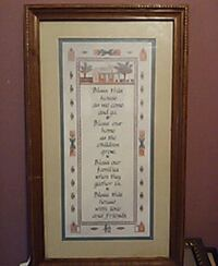 white, brown, and green quote-printed board decor with wooden frame