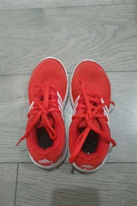 pair of red Nike running shoes Vancouver, V5X 2M5