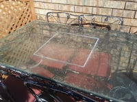 Old glass patio table and four chairs Tuscaloosa, 35404