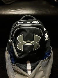 black and gray Under Armour backpack