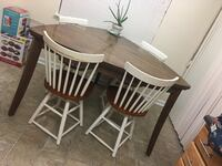 round brown wooden table with four chairs dining set Laurel, 20723