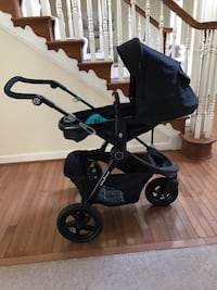 baby's black and blue stroller 1 km