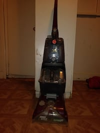 black Bissell upright vacuum cleaner 1198 mi