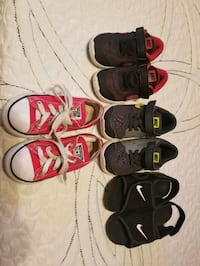 four pairs of assorted-color shoes 1183 mi