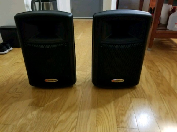 Two Powered DJ Speakers with Stands