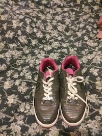 pair of gray-and-red Nike running shoes Huntsville, 35816