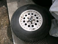 gray bullet-hole car wheel with tire
