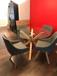 black wooden framed glass top table with chairs Calgary, T2T 1W8