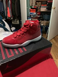 unpaired red Air Jordan 11 shoe with box New York, 10453