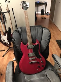 Red and black electric guitar Kelowna, V4T