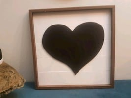 Beautiful wood picture of black heart with wood frame.