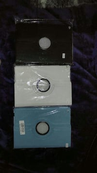 three black, white, and teal leather flip covers Toronto, M9B
