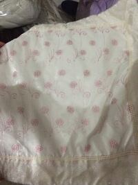 White and pink textile