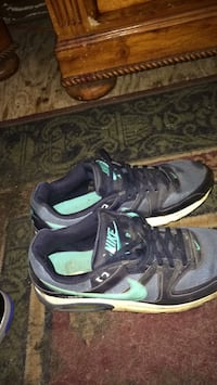 pair of black-and-green Nike basketball shoes San Angelo, 76903