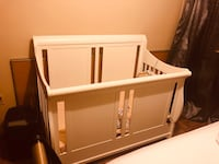 Excellent condition white wooden crib and dresser set.  Toronto, M6L 2E1