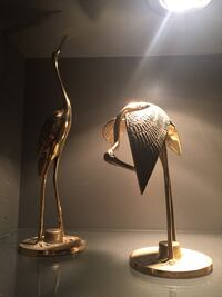 Two gold heron statues