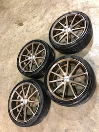 four gray multispoke vehicle wheels and tires Barnesville, 30204